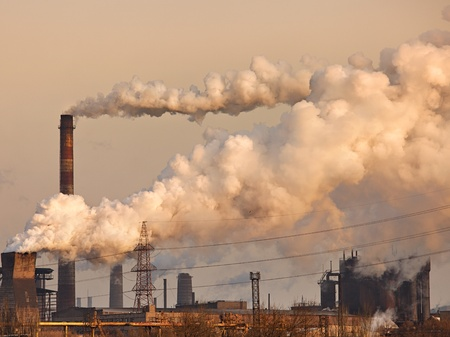 pollution: Chemical factory with smoke stack Stock Photo