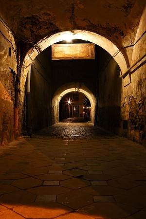 Dark street in the old eurpean city photo
