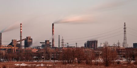 Industrial plant air pollutions with smoke stack photo