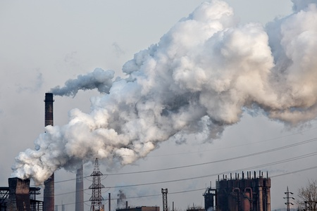 Industrial plant with white smoke  Air pollution concept