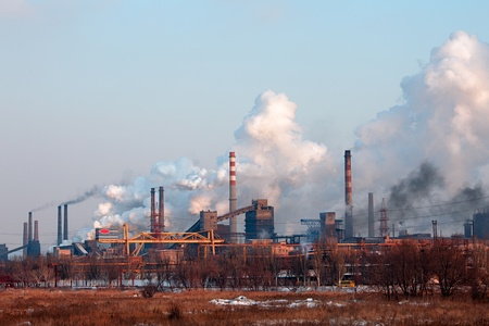 Industrial landscape with factory chimney and smoke 스톡 콘텐츠