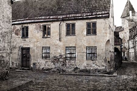 Retro style image of old european street photo