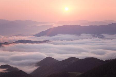 Sunrise over cloudy mountain ridge Stock Photo - 24170266