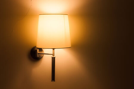 Lighted classic lamp on the wall photo