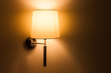 sconce: Lighted classic lamp on the wall Stock Photo