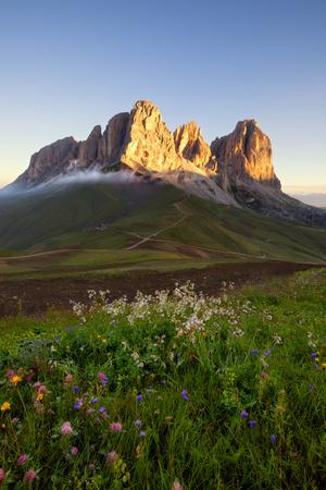 sella: Sassolungo mountain peaks at sunrise, Italian Dolomites