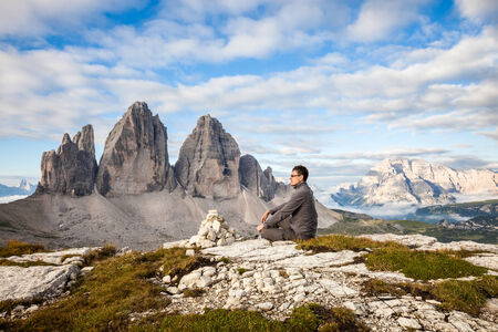 dolomite: Man sitting on the top of the mountain