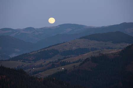 Moonrise over Carpathian mountains hills, Ukraine Stock Photo