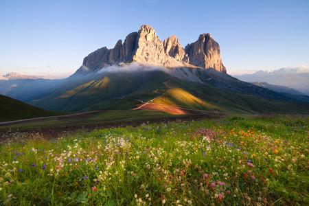dolomites: Sassolungo mountain peaks at sunrise, Italian Dolomites