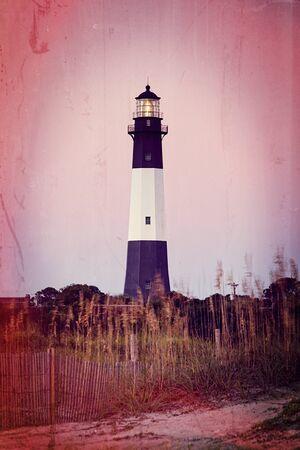 tybee island: Retro style photo of lighthouse at sunrise, Tybee island, USA