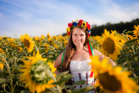 Close-up portrait of beautiful young woman with sunflower photo