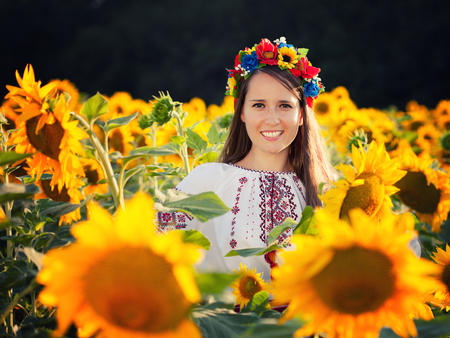 Beautiful young girl at sunflower field  Ukrainian girl photo