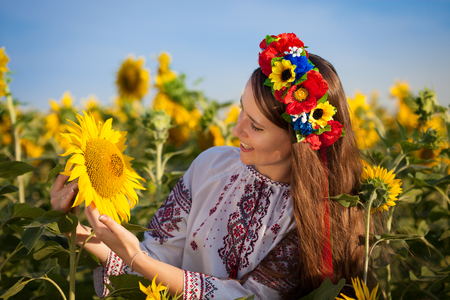 Beautiful young woman at sunflower field  Ukrainian woman photo