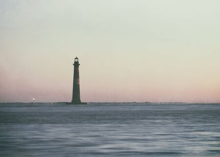 morris: Vintage style photo of Morris Island Lighthouse at sunrise, South Carolina, USA