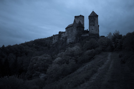 middleages: Medieval castle at night with stormy sky