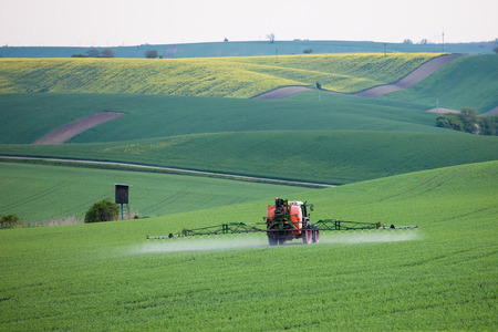 spraying: Tractor spraying fields Stock Photo