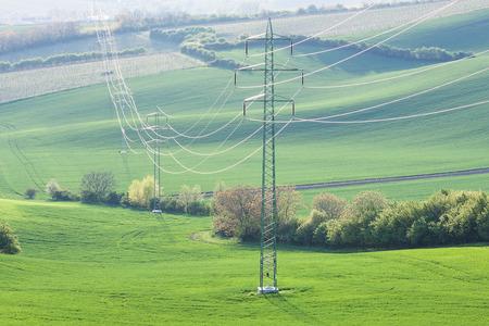 torres el�ctricas: High voltage lines and power pylons at the rural landscape Foto de archivo
