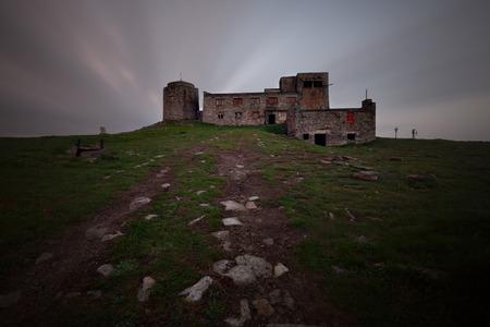 green ridge: Old dark castle ruins Stock Photo