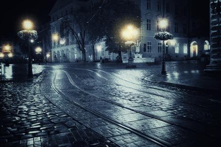 rain weather: Old European city at rainy night