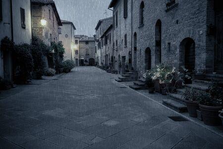 pienza: Old European street after dark. Pienza, Tuscany, Italy. Stock Photo