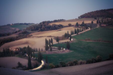 serpentine: Serpentine road at dusk. Tuscany, Italy Stock Photo