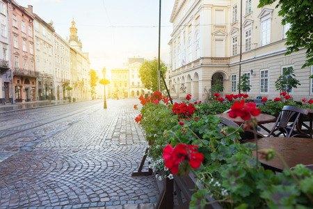 Street cafe terrace with tables and flowers in European city Stock Photo