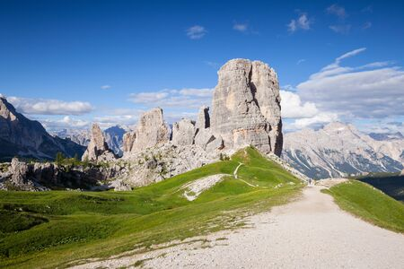 torri: Summer mountain alpine meadow panorama. Cinque Torri, Dolomites Alps, Italy