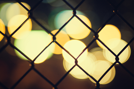 wire mesh: Nigh city bokeh lights through the wire mesh fence
