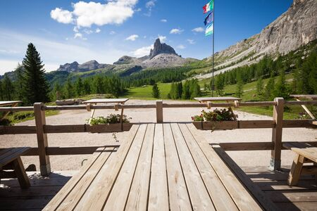 table mountain national park: Alpine mountain rifugio wooden table. Outdoor restaurant