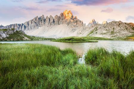 Alpine mountain lake at sunny morning, Tre Cime, Italian Dolomites