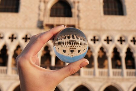 Venice architecture palace doges view through crystal glass ball Stock Photo