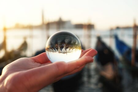 Venice gondola view through crystal glass ball
