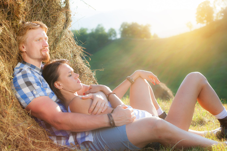 Beautiful couple in love at the hay Banque d'images