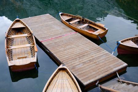 Boats at the alpine mountain lake. Lago di Braies, Dolomites Alps, Italy Stock Photo