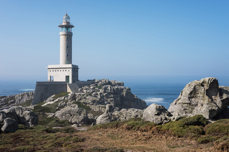 Punta Nariga Lighthouse at sunny summer day, Spain