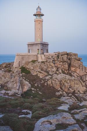 Punta Nariga Lighthouse in Costa da Morte, Galicia, Spain. Stock Photo - 98370686