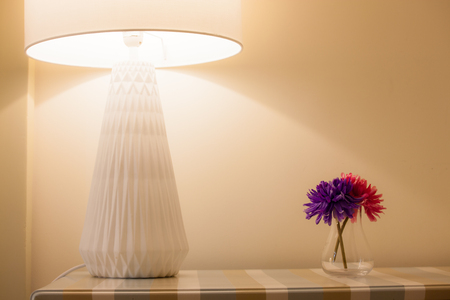 Lamp and flowers on a wooden table