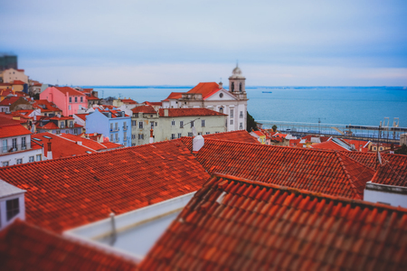 Top view of Lisbon downtown red roof buildings. Artistic miniature tilt shift effect.