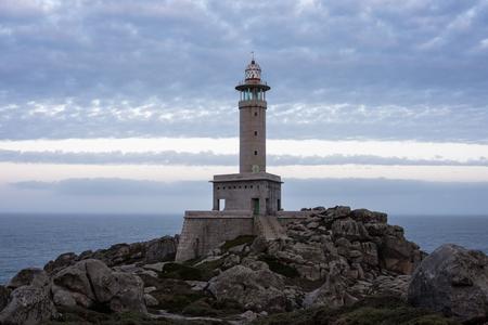 Punta Nariga Lighthouse in Costa da Morte, Galicia, Spain. Stock Photo