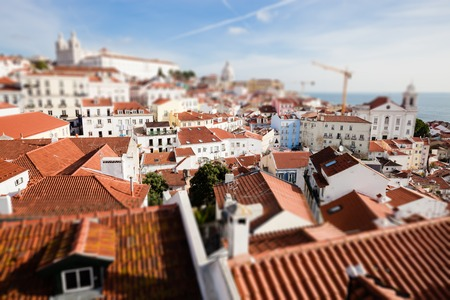 Top view of Lisbon downtown red roof buildings. Artistic miniature tilt shift effect.