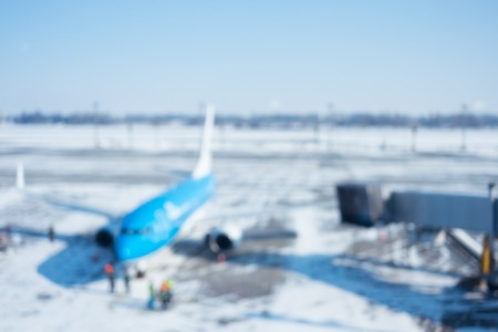Blur of airplane at airport gate abstract background