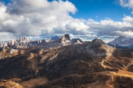 Passo Falzarego at sunny autumn day. Panoramic view. Dolomites Alps, Italy