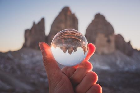 Tre Cime mountain view through crystal glass globe. Dolomites Alps, Italy Stock Photo
