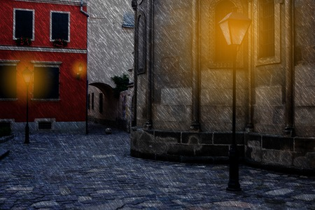 Old European city at rainy dark night Imagens