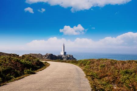 Punta Nariga Lighthouse at sunny summer day, Spain