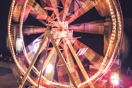 Ferris wheel in a night park. Entertainment in the carnival park.