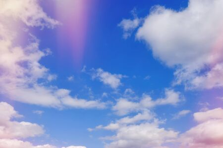 Blue sky with clouds and red flare abstract nature background Stockfoto