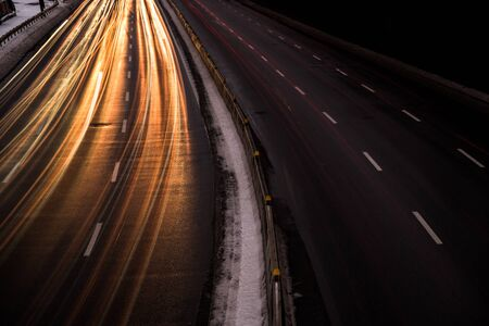 The car light trails on the highway in the night modern city