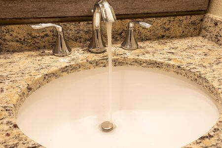 Luxury bath tub and faucet with water. Stockfoto