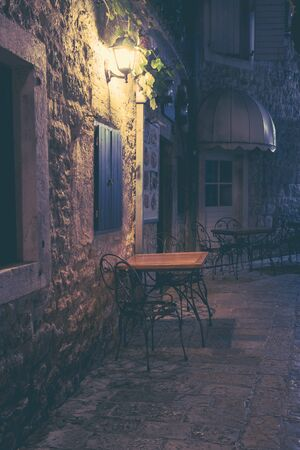Old street at night illuminated by vintage streetlight. Budva, Montenegro